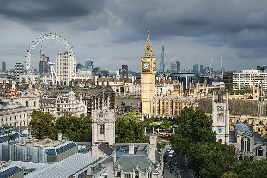 View across London rooftops to the Houses of Parliament and the London Eye.