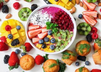assorted sliced fruits in white ceramic bowl