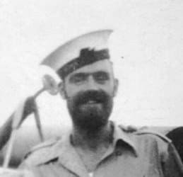 """Photo of the author's dad """"Sailor Sam"""" in his sailor's uniform during World War Two."""