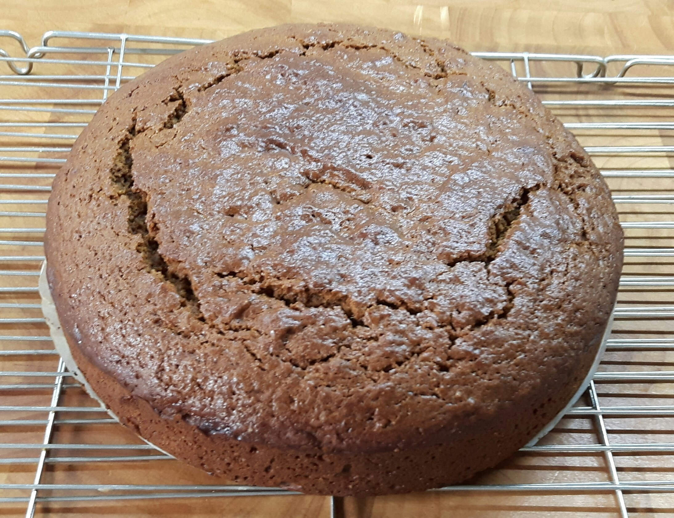 A baked moggy cake cooling on a rack.
