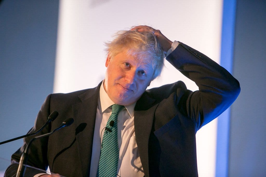 Johnson scratching his head