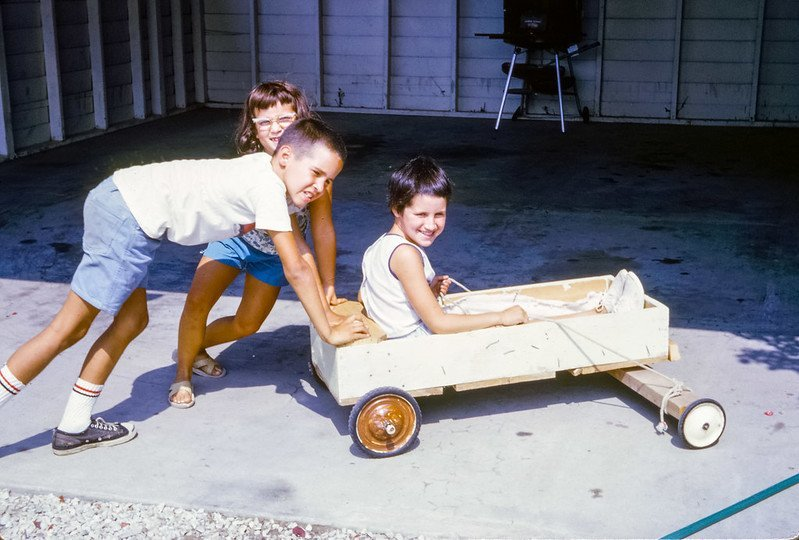 Picture of kids in a homemade go cart