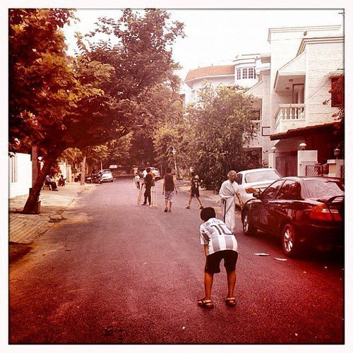 Image of children playing cricket in the street in Bangalore
