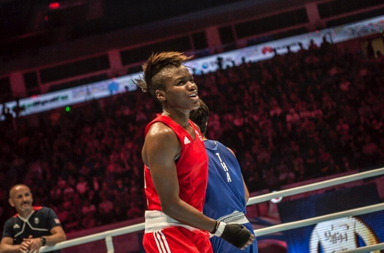 Image description: Nicola Adams, in red, at a boxing tournament in Astana.