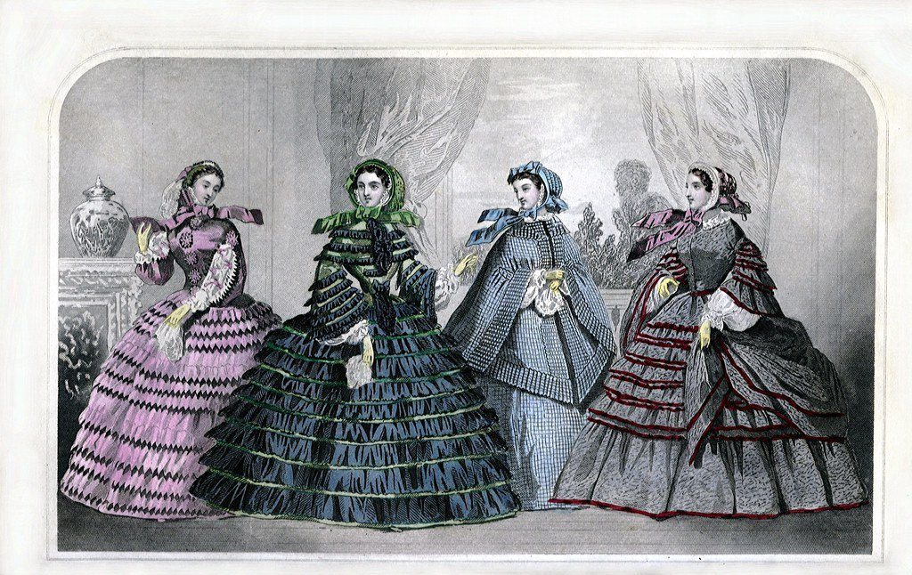 Image is March 1860 Godey's Lady's Book Fashion Plate - four women in posh frocks