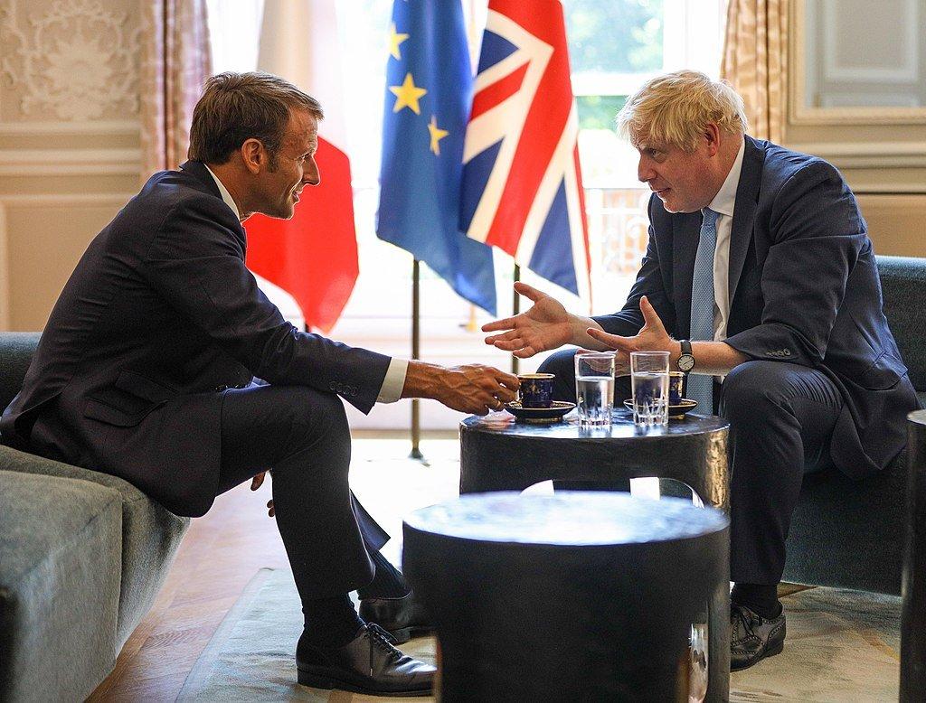 Boris Johnson with president Macron discussing Brexit