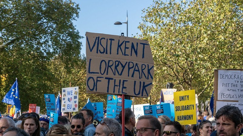"""Protest placard saying """"visit Kent lorry park of the uk"""""""