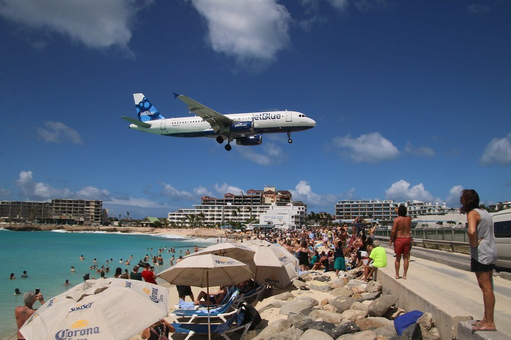 Image of airplane flying over a holiday resort