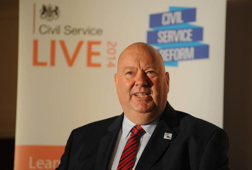 Image description: Liverpool Mayor Joe Anderson speaking at a civil service event in 2014.