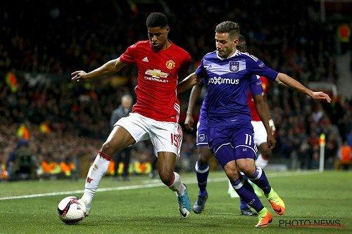 Image description: Marcus Rashford, in red Man Utd. kit, playing football.