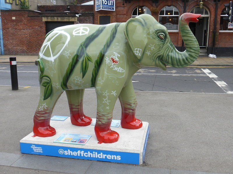 Green elephant statue with CND logos in Sheffield