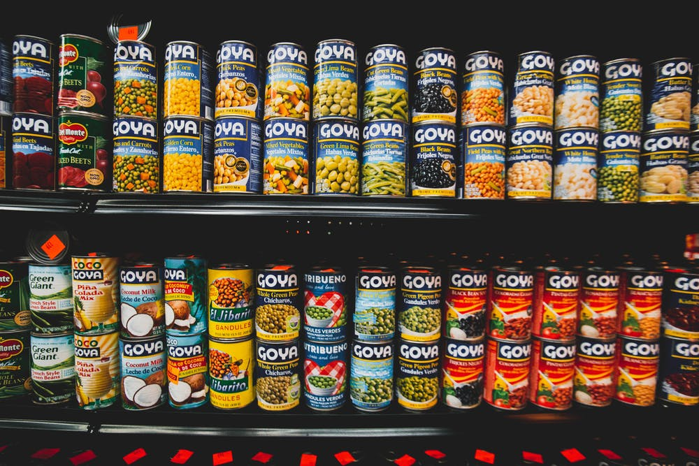 Image description: shelves packed with cans