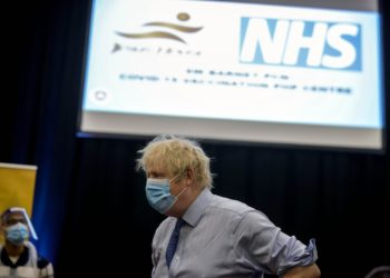 07/03/2021. London, United Kingdom. Boris Johnson visit Jesus House vaccination Centre. The Prime Minister Boris Johnson visits Jesus House vaccination centre in North London, during lockdown in the Covid-19 pandemic. Picture by Andrew Parsons / No 10 Downing Street