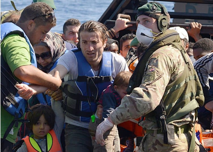 HMS Bulwark Delivers Hundreds of Migrants to Safety in Italy