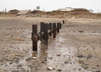 Drainage outfall at Kilnsea by Stephen Craven and licensed for reuse under this Creative Commons Licence.